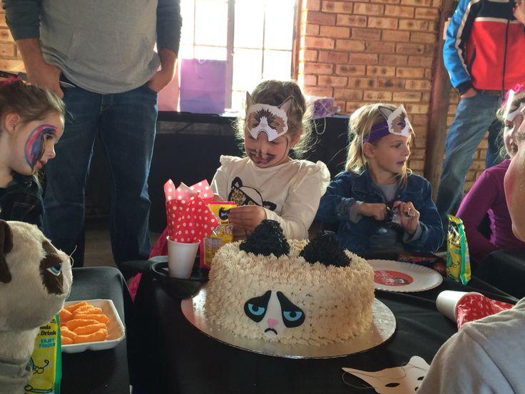Madi's 6 birthday Grumpy Cat cake...strawberry & loved by all