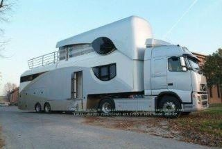 2 Story Camper Trailer   Volvo truck with a two story RV, for the people who live in America ...