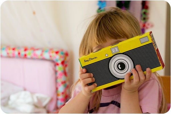Turn an empty mac and cheese box into a pretend camera for kids!