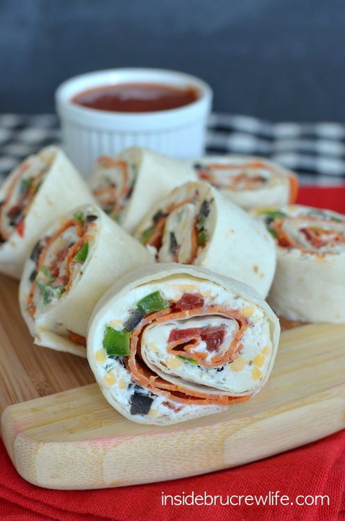 These delicious Pizza Pinwheels are fantastic for your next game-day party! Your guests will love the cheesiness of this twist on pizza!