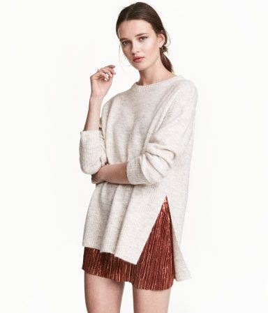 Check this out! Oversized sweater in a melange knit with wool and alpaca wool content. Rib-knit sections at sides, wide ribbing at cuffs and hem, and slits at sides. Slightly longer at back. - Visit hm.com to see more.