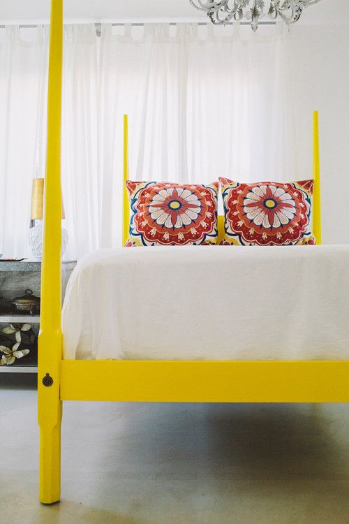 In sunny Southern California, designer Betsy Ginn of SMID gave her childhood bed a new lease on life with a bright pop of yellow.