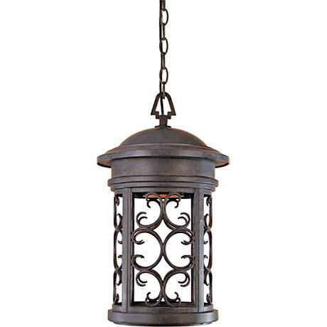 Its rich patina finish adds to this chain-hung outdoor light's Mediterranean appeal.