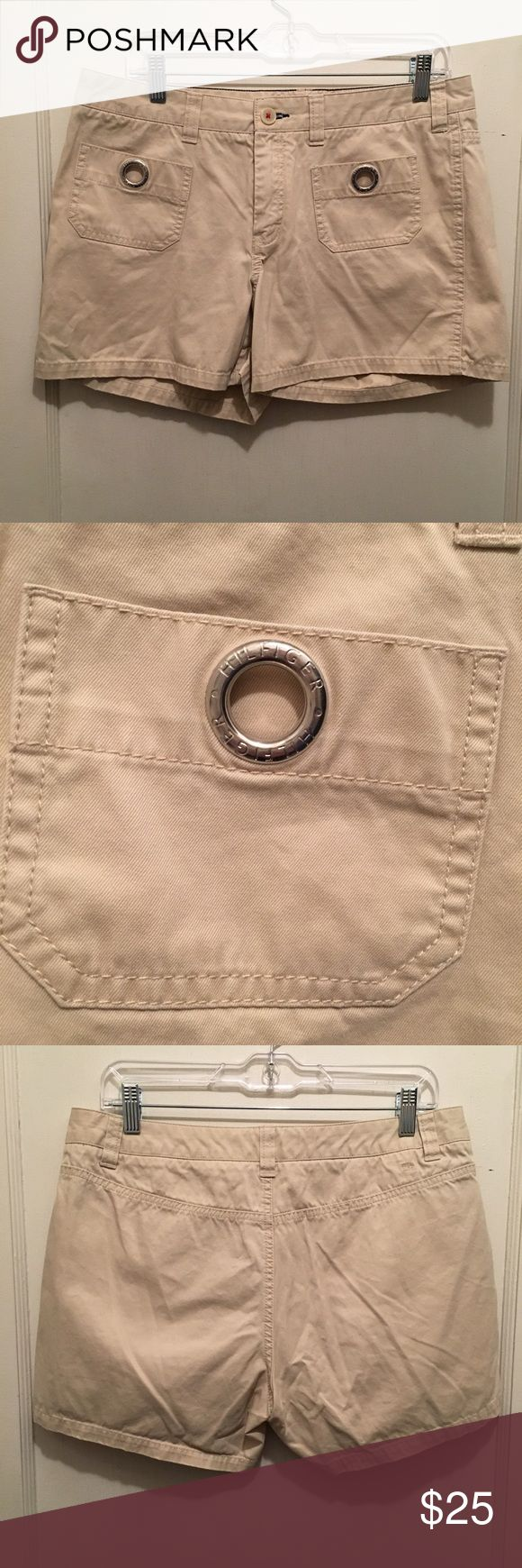Khaki Tommy Hilfiger Women's Shorts These Tommy Hilfiger Khaki shorts are super cute! They have front pockets with silver circles that have Tommy Hilfiger stamped in the metal. These are petite. Tommy Hilfiger Shorts