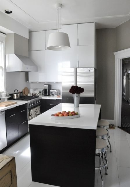 island is very very useful. white and grey kitchen makes it look big.