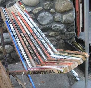 Nothing says Canadiana like a good ol'chair made from broken hockey sticks.