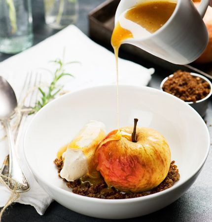 baked apple with milk ice cream and caramel