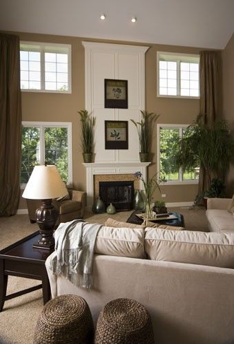 I love the high windows along the fireplace in this neutral living room with great molding.    South Shore Decorating Blog: Neutral Rooms