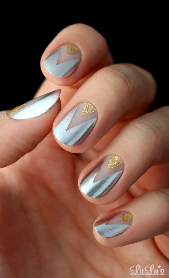 Gold and Silver Chevron Nail.  I'd also do this with burgundy and black glitter polishes.