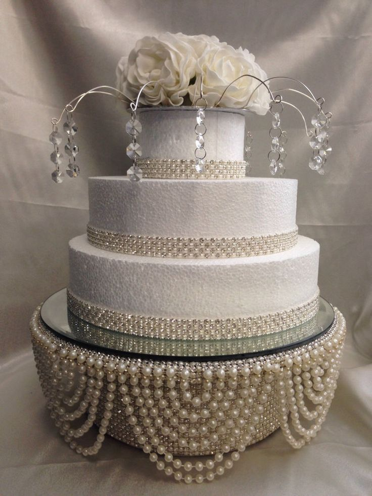 Pearl swag drape & Crystal cake stand. This breath taking drape design wedding cake stand has a real glass mirror top and is made in many sizes in both round round or square shape. This stand is strong enough to use as a base stand for cake weights of up to 50kg / 4-5 tiers.   eBay!