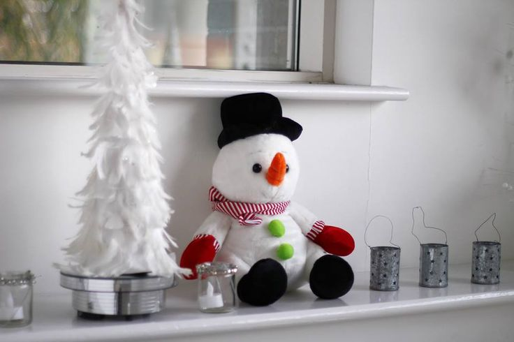 Frosty has a good view of all the employees coming and going as he sits on his windowsill surrounded by festive candles and his very own snow-covered tree!