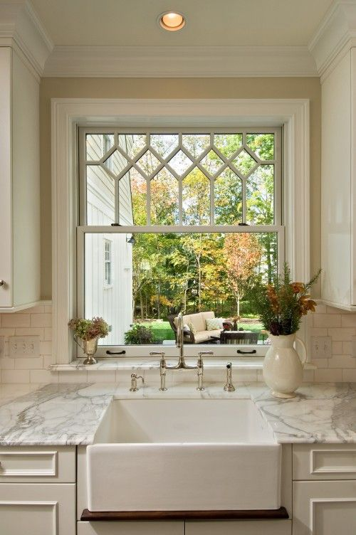 Eclectic Mix Of Eras And Styles In This Kitchen Farmhouse Sink Fixture White Marble Counter Leaded Glass Style Window Subway Tiles Backsplash