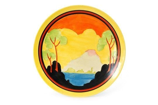CLARICE CLIFF 'APPLIQUÉ ETNA' DISH PLAQUE  The hammer fell at a solid £2,400 yesterday for this rare Clarice Cliff 'Appliqué Etna' 26cm Dish Plaque.  The auctioneers set a wide £2,000-3,000 estimate but it was not expected to achieve the higher end.  The plaque was in good condition except for some crazing on both sides and a few small scratches to the central decoration.  It formed part of Fieldings' major Decades of Design Auction with the successful bid coming from the internet.  4 March…