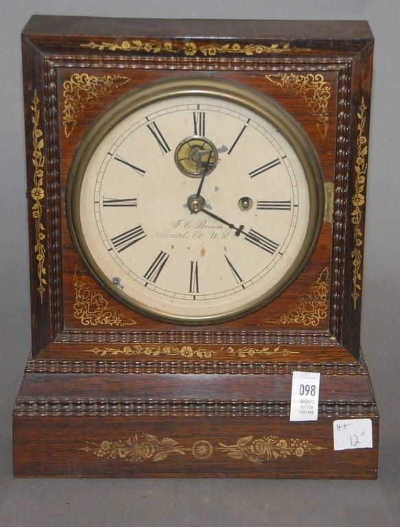 "J. C. Brown rosewood shelf clock with ripple molding marked J. C. Brown Bristol CT. U.S., ht. 12"". - Realized Price: $2,300.00"