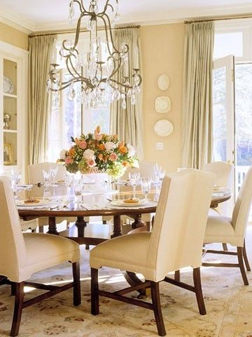round dining table, french doors with transom lights above, drapes go all the way to the ceiling- by BHG