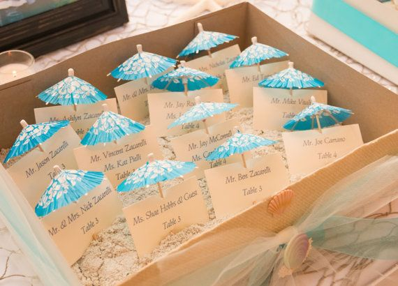 Bring the beach to your wedding or bridal shower with these unique, elegant flat escort/place cards anchored on mini, folding beach umbrellas!
