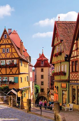 The charming streets of Rothenburg-ob-der Tauber, Germany - I've been here, and it's, like, the most picturesque, quaint touristy town you can imagine. Beautiful cathedral and a morning market on Saturday. I've been twice and I'll definitely go again.