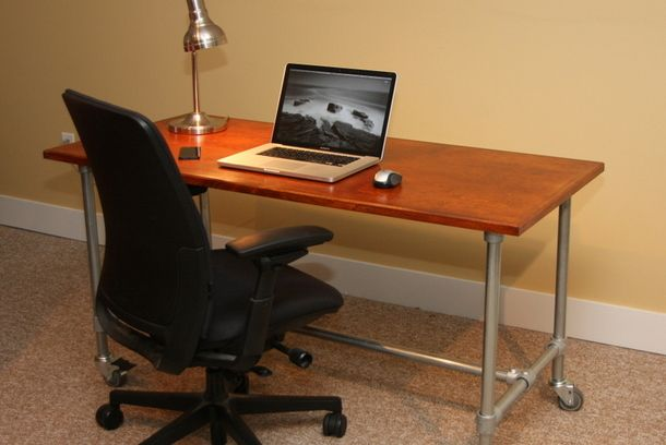 Building your own rolling desk with Kee Klamp, pipe and a desktop.  Bring your DIY skills to bear on the simple project.