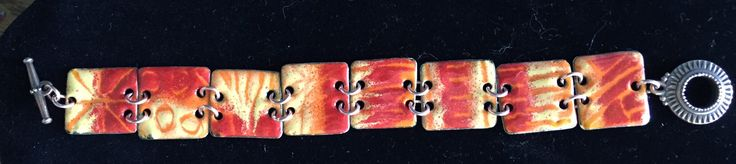 "Torch fired enamel on copper using the ""sgraffito"" technique.    ""Fire"""