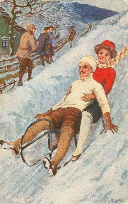 man & woman toboggan downhill