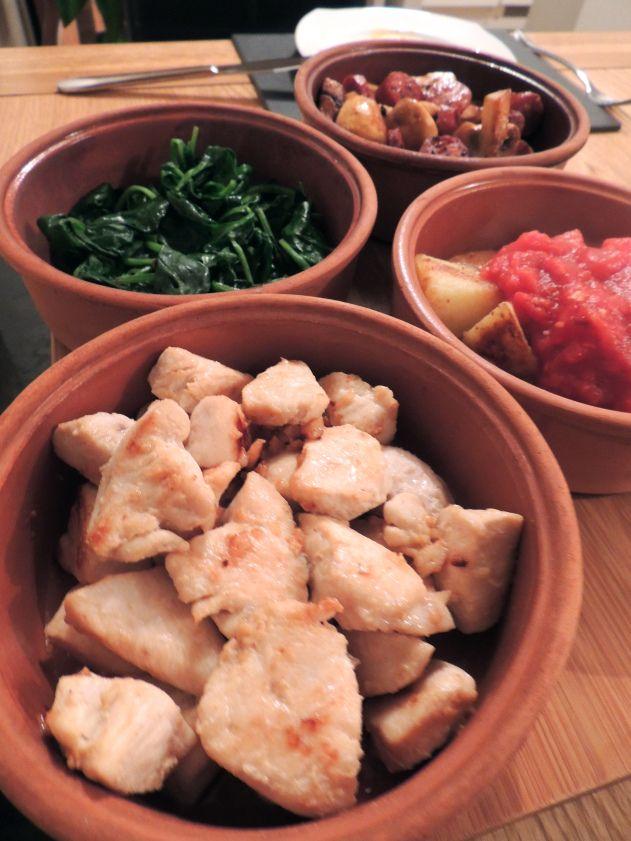 Garlic chicken, catalan spinach, patatas bravas and mushrooms and chorizo.