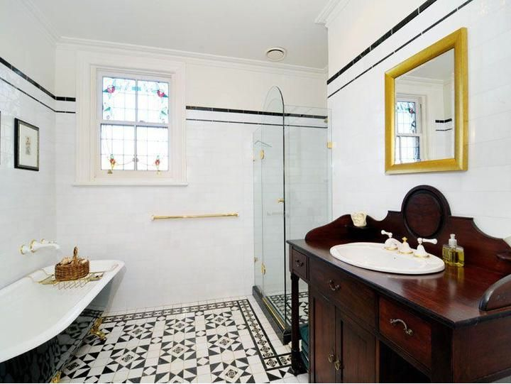 Original Federation bathroom with appropriate or authentic fittings and washstand with modern shower in sympathetic style