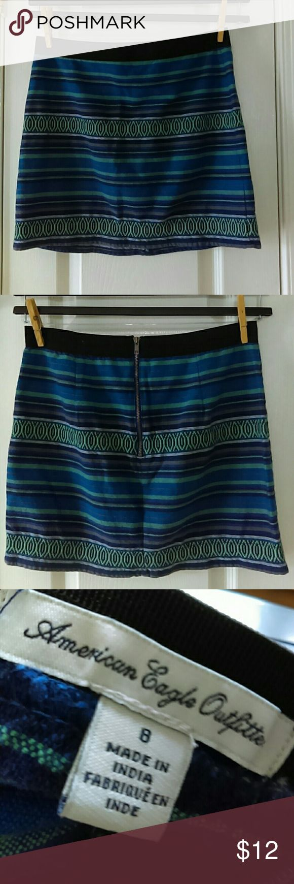 American Eagle Outfitter mini skirt American Eagle Outfitter mini skirt with elastic band waist exposed zipper back cute skirt can be worn with black leggings and boots for a cool winter look Length approximately 15 inches American Eagle Outfitters Skirts Mini
