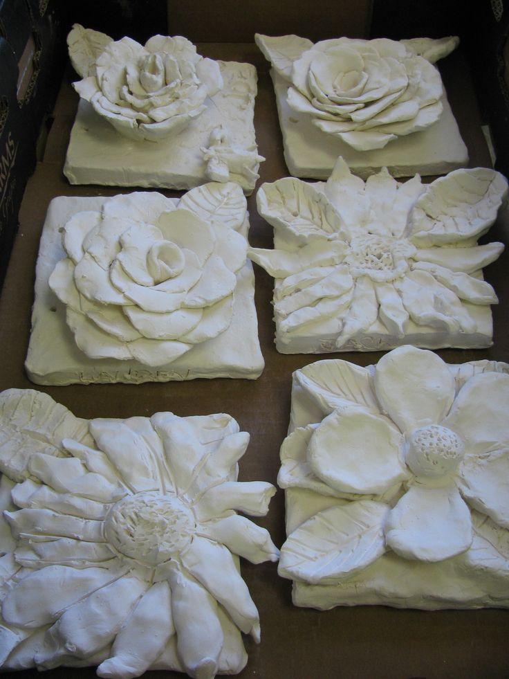 """4th grade ceramic flower sculptures; approx. 7""""X 7"""" per flower ; lesson designed by art teacher: Susan Joe"""