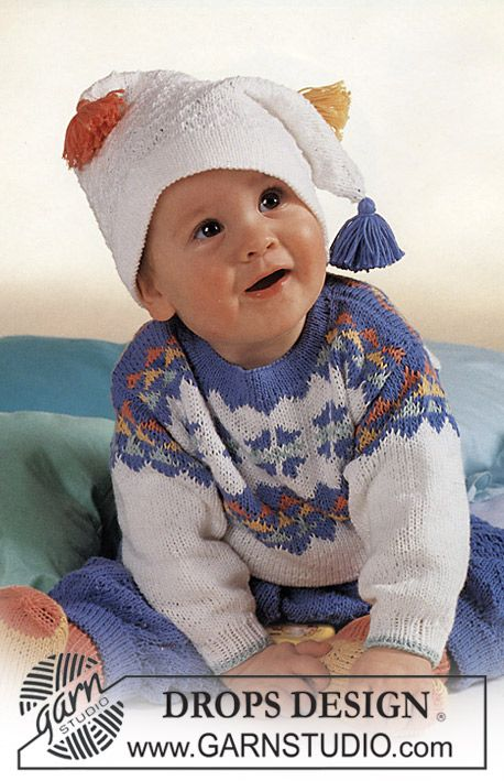 "DROPS jumper with star pattern, trousers, hat and socks in ""Camelia"". Size 3-24 mos."
