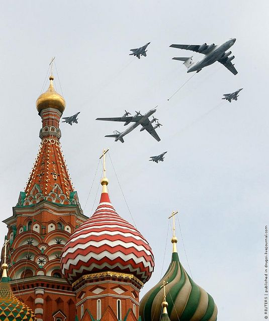 Russian military aircraft fly in formation over St. Bazils Cathedral in Red Square there are 4 su flankers, Cargo Plane is bigger than our C-5, last big one is a Bear   Bomber