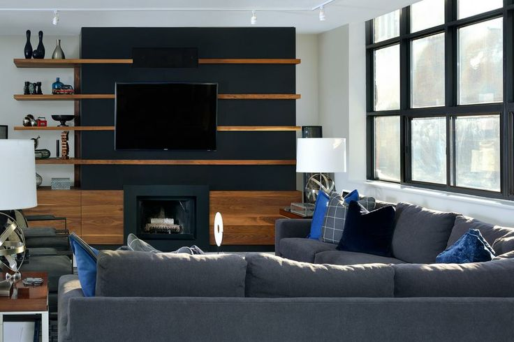 Living room space designed by Glen & Jamie from Peloso Alexander Interiors. #GlenandJamie #Design #sofa #chairs #tv #shelving #lamp