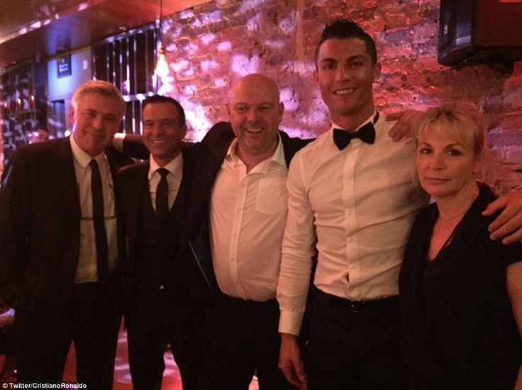 Ronaldo poses with Italian manager Carlo Ancelotti (left) and agent Jorge Mendes (second left) as he hails a 'great night' in London
