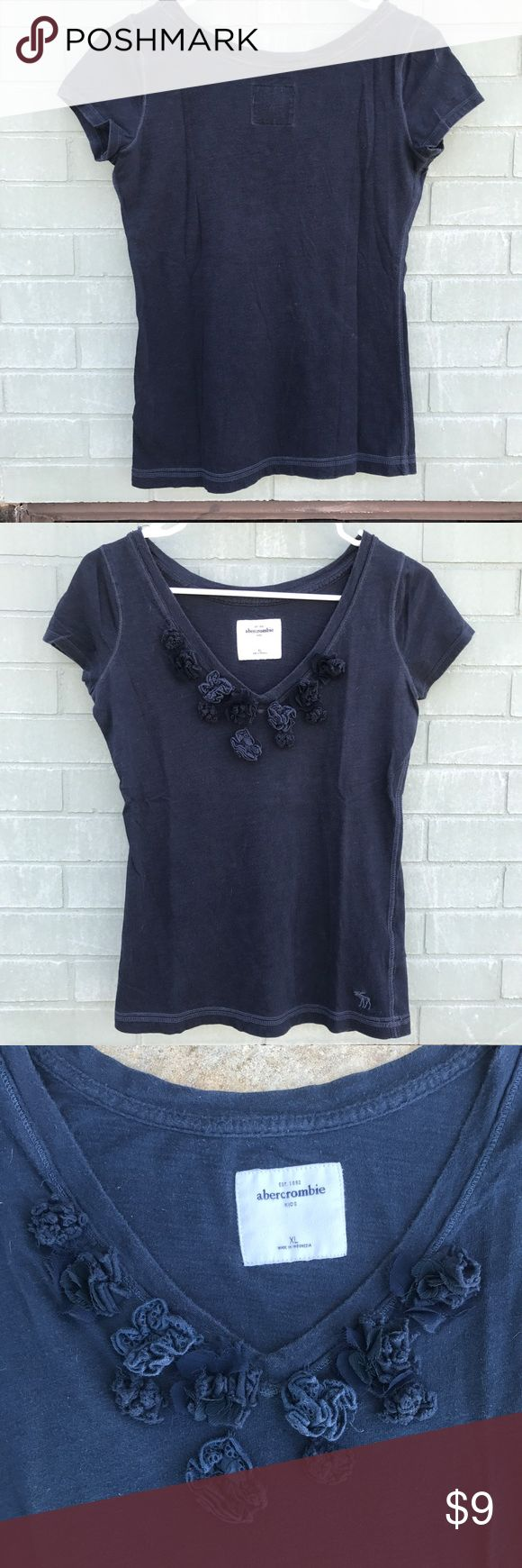 Abercrombie Kids V-Neck with Flower Details Navy blue Abercrombie & Fitch v-neck with cloth flowers on the front. Size is child XL but I usually wear an adult size XS or S and it fits me well (see picture). abercrombie kids Tops Tees - Short Sleeve