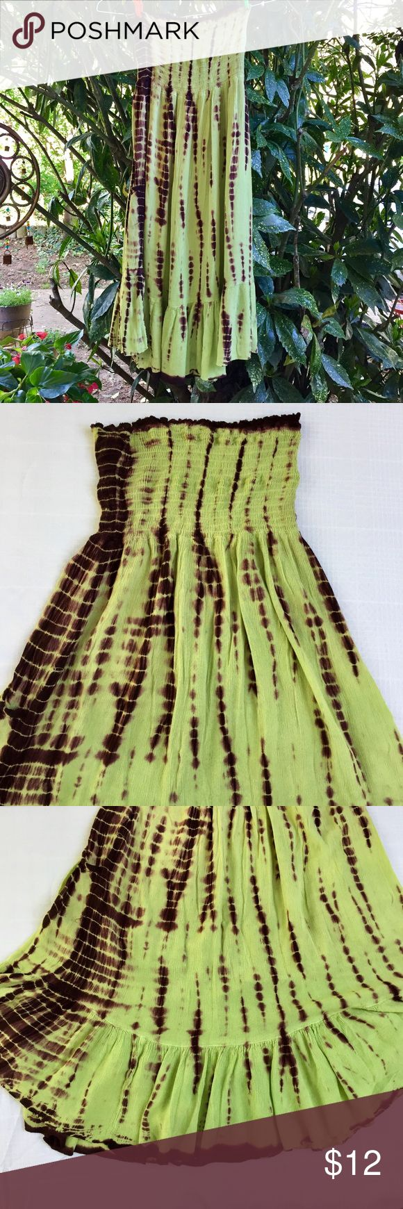 Boutique Tie dye strapless dress Boutique Tie dye strapless dress Tight fitted on top and loose at the bottom, also has pockets. Super comfy, brown and green tie dye pattern. Can be used as a sundress or a bathing suit cover up. Tag says free size, but I would say XS-XL  depending where you want the dress to fall. I'm size M-L and it falls just below the knee. Fabric is 100% Rayon Boutique Dresses Strapless