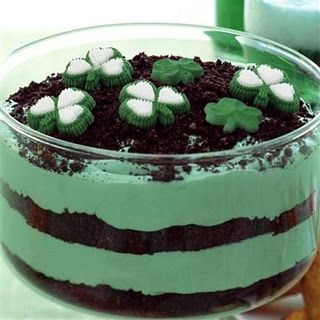Green Pudding Recipe   Ingredients:  • 2 boxes (4 serving size each) of JELLO vanilla flavor instant pudding  {or use JELLO pistachio flavor instant pudding & eliminate the green food coloring}   • 3 1/2 cups cold milk  • 1 teaspoon green food coloring  • 1 tub Cool Whip (8 oz.)  • 1-18oz pkg. Oreos, coarsely crushed  • Shamrock candies, cookies, etc. for garnish