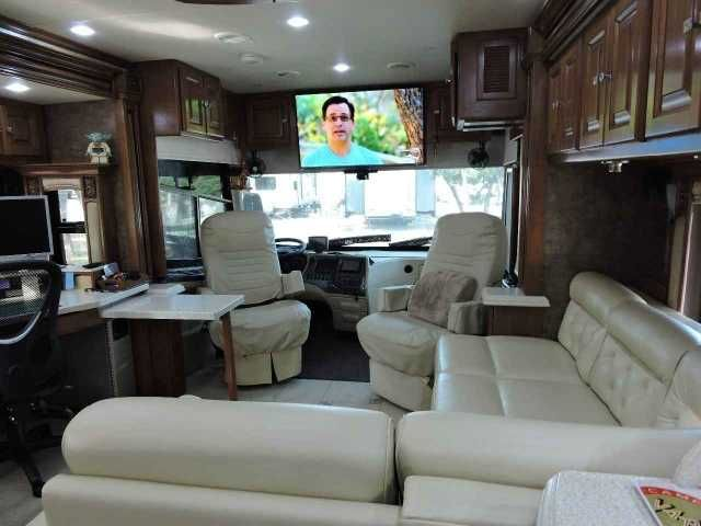 2011 Used Tiffin Motorhomes Allegro Bus 43QGP Class A in Florida FL.Recreational Vehicle, rv, Dear RV Enthusiast, We are offering our 2011 Tiffin Motorhome Allegro Bus 43QGP 43 foot bus, which has been professionally maintained and in immaculate condition. Features king sleep number bed, 4 flat screen TVs. Surround sound. Kitchen with convection microwave oven, glass two-burner cooktop with cover. Dishwasher, and pull out island. Custom Villa L-Shaped sleeper sofa with foot rests. All LED…