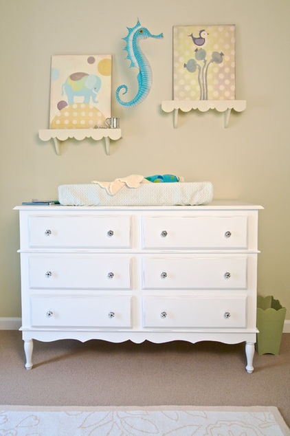 will definitely be doing this when we have a kiddo one day.  no sense in buying a changing table when we have perfectly good dressers!
