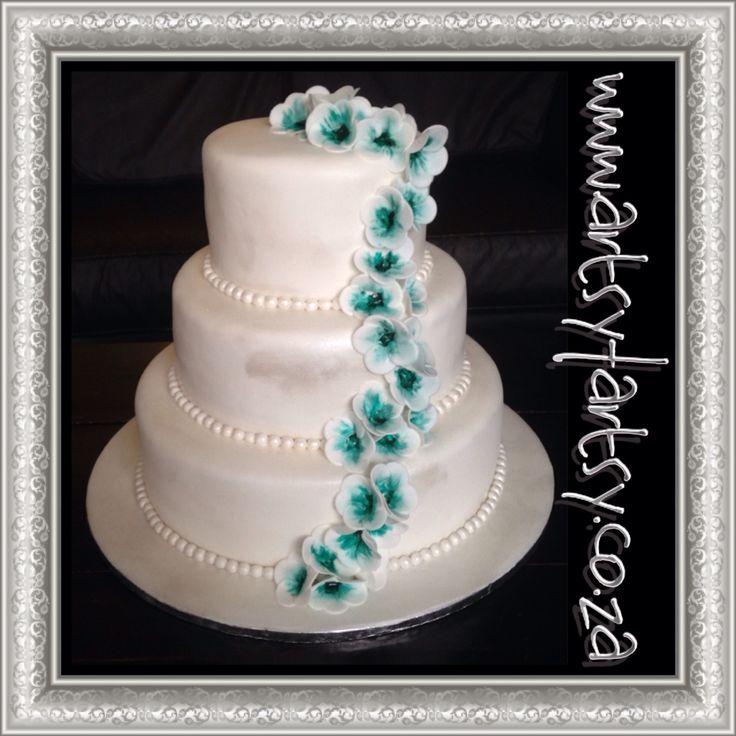 Red Velvet Wedding Cake with Turquoise Flowers #redvelvetweddingcake #turquoiseweddingcake