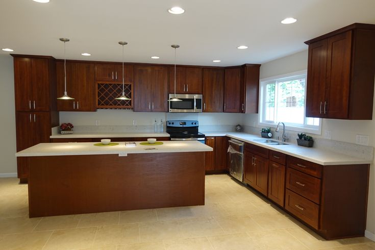 medium brown cabinets with white quartz countertop ...