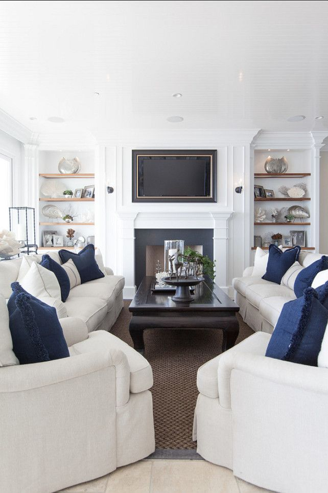 Classic Beach House With Coastal Interiors Framed TvLiving Room