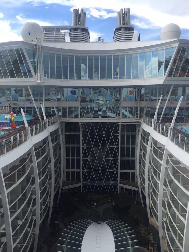 The cruise ship is massive, like a floating city.