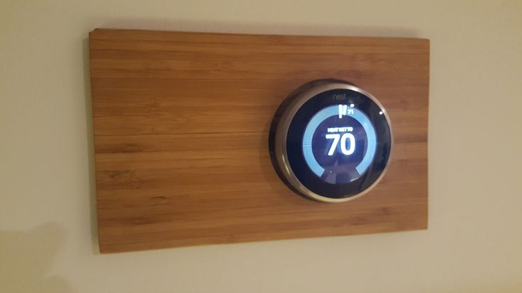 Bamboo decorative wall plate for Nest smart thermostat