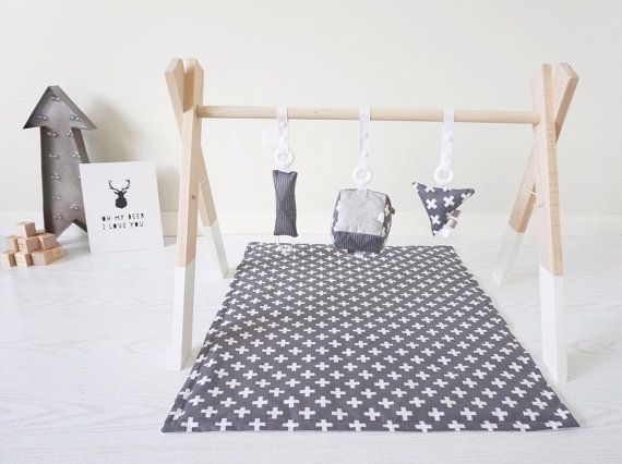 Our handmade wooden play gym is a perfect place to stimulate babys senses but is also designed to look aesthetically pleasing in your home.