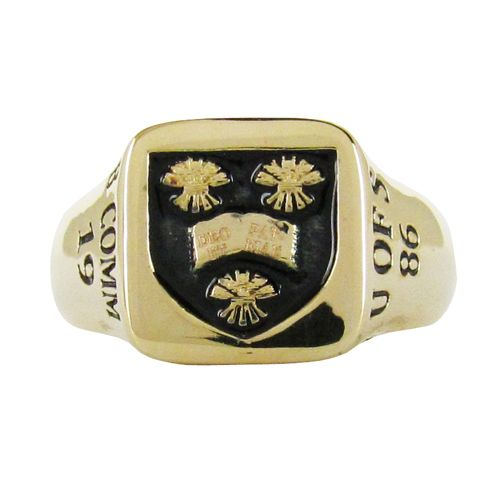 CUSTOM MEN'S SIGNET RING  A custom men's signet ring in 14 karat yellow gold.