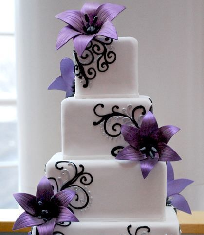 square cake with purple flowers.