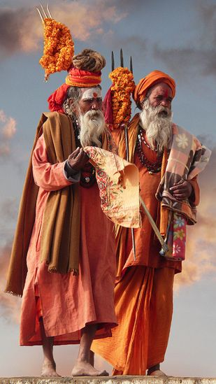 The Patriarchs by Laurent Goldstein - Saddhus walking along the Ganges in Varanasi (Benaras)