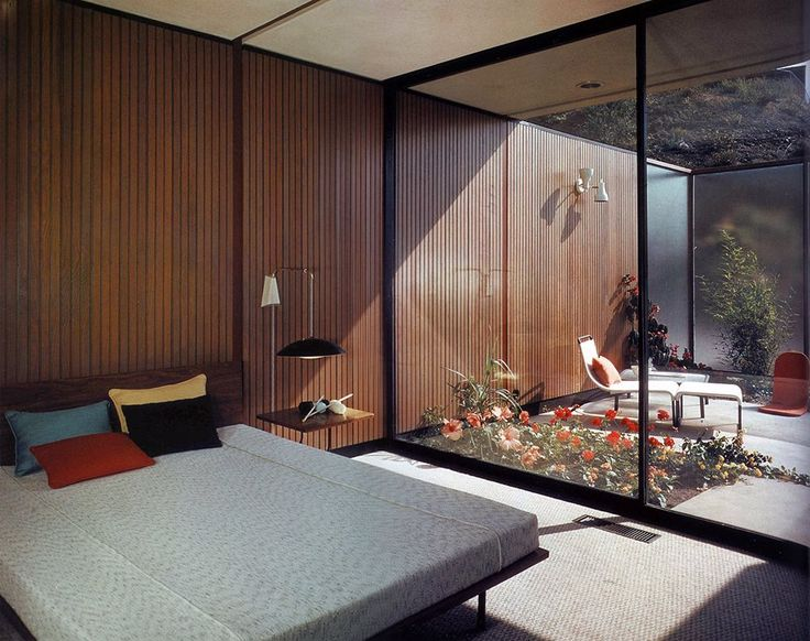 Bedroom with private garden. A bedroom in Case Study House #16. Located in Bel Air, California it was designed by Rodney Walker and completed in 1953. Photo: Shulman / Getty