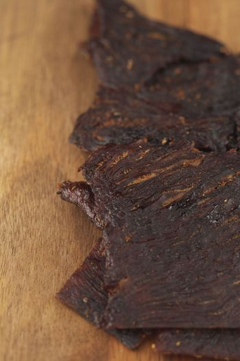 Learn the basics of making jerky of all types in your backyard smoker. With patience and a little practice, smoked jerky is easy.