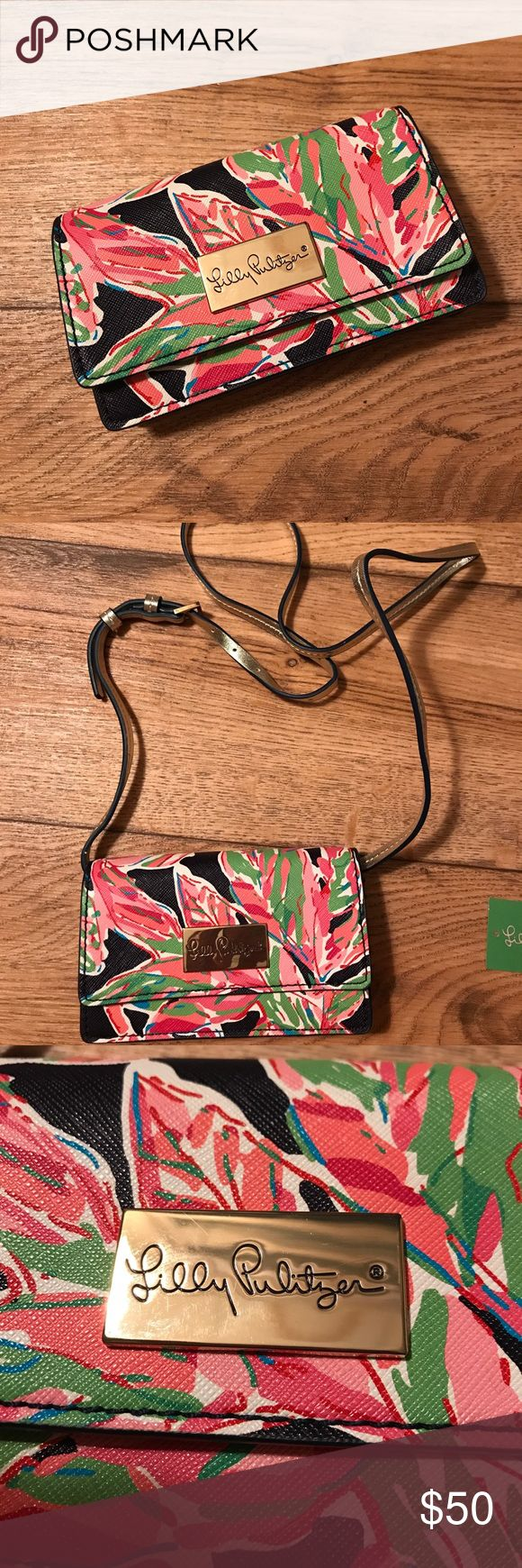 "🆕Lilly Pulitzer It's A Date Crossbody Bag Cute crossbody bag, 7"" long, 4"" high. Pattern is ""in the vias"". Has three inner card slots and a cash slot, and will hold an iPhone 7. Gold-tone strap is adjustable and removable, drop is +/-24"". Used a few times, there is one white mark on the back that I haven't tried to remove. Retail $88. PRICE IS FIRM🚫NO TRADES Lilly Pulitzer Bags Crossbody Bags"