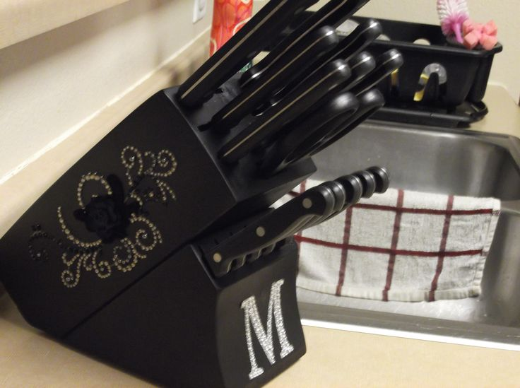Redo your knife block.  I used black spray paint and bought a few embelishments from Hobby Lobby from the scrapbooking section. Super easy and fun to do!